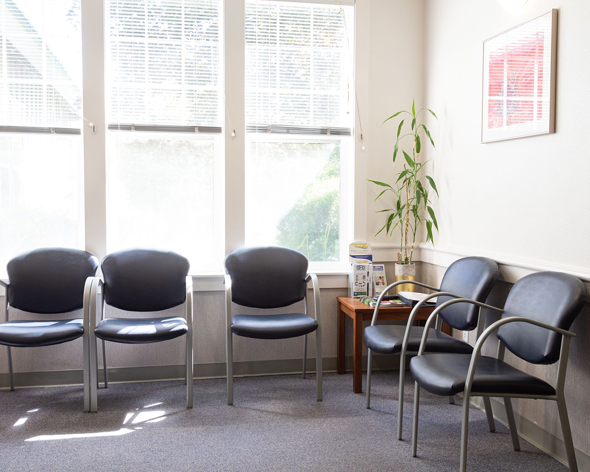 Waiting room with black chairs and natural light